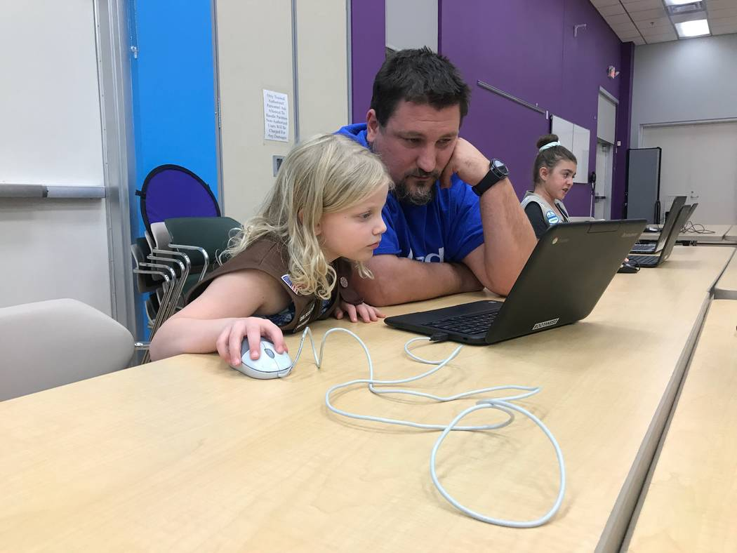 Steven Lawrence practices coding activities with his daughter on Oct. 9, 2017 at the Girl Scouts of Southern Nevada headquarters, 2941 E. Harris Ave. (Kailyn Brown/View) @KailynHype