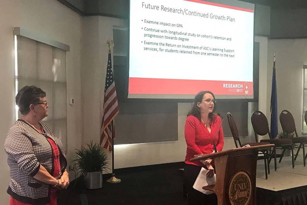 Dr. Anne White, director of learning support for the Academic Success Center at UNLV, left, and Dr. Brandy Smith, special assistant to the dean for the Academic Success Center, present data on aca ...