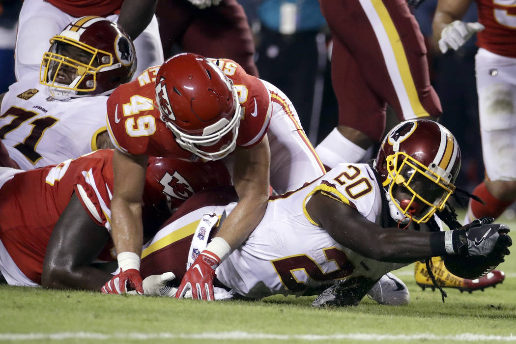 Washington Redskins running back Rob Kelley (20) fails to reach the end zone as Kansas City Chiefs defensive back Daniel Sorensen (49) and a teammate defend during the first half of an NFL footbal ...