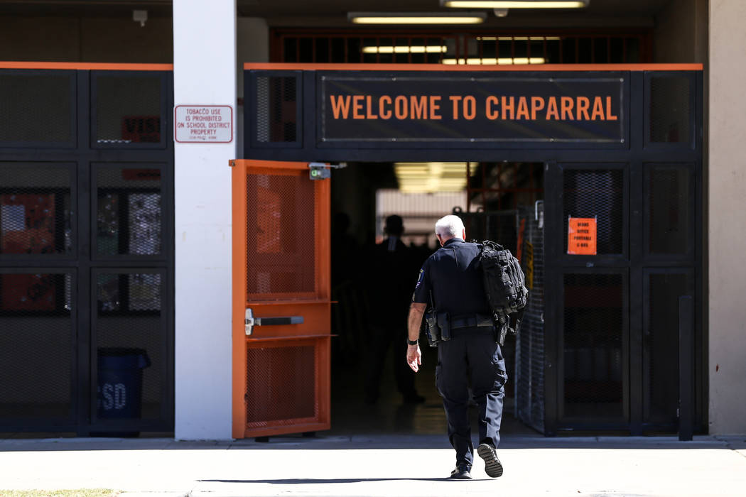 A Clark County School District police officer heads towards Chaparral High School after a student was stabbed in the chest in Las Vegas, Tuesday, Oct. 10, 2017. Joel Angel Juarez Las Vegas Review- ...