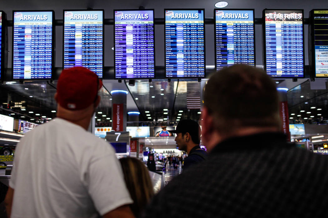 People check out arrival flight info at McCarran International Airport Terminal 1 baggage claim in Las Vegas, Friday, Oct. 13, 2017. Joel Angel Juarez Las Vegas Review-Journal @jajuarezphoto