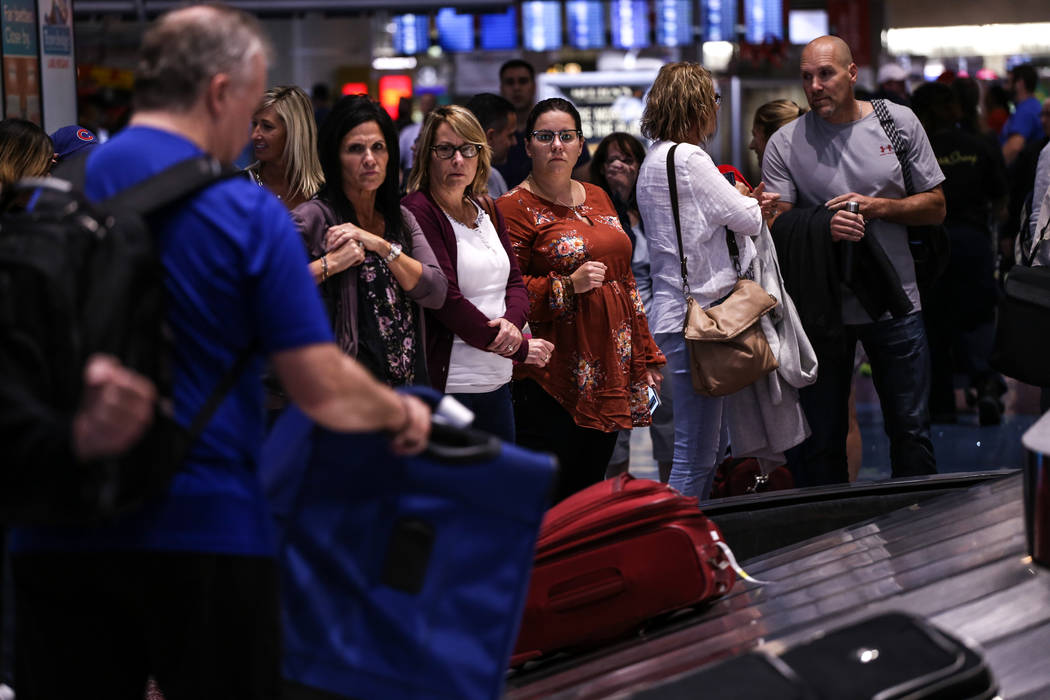 People wait to pick up their luggage at McCarran International Airport Terminal 1 baggage claim in Las Vegas, Friday, Oct. 13, 2017. Joel Angel Juarez Las Vegas Review-Journal @jajuarezphoto