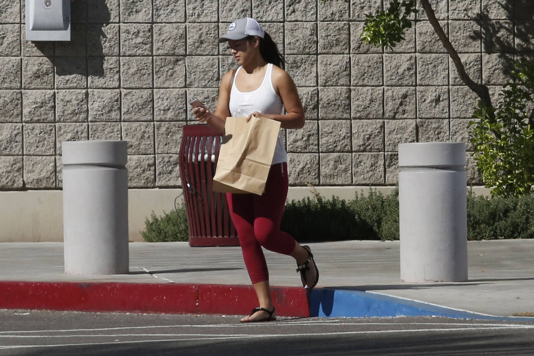 A woman leaves the Family Assistance Center at the Las Vegas Convention Center where survivors of last week's deadly Las Vegas shooting retrieve their belongings, Monday, Oct. 9, 2017. (Bizuayehu  ...