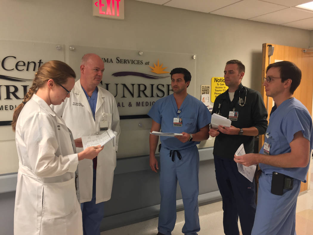 Dr. Allan MacIntyre, second from left, and the surgery residents that were on duty at Sunrise Hospital and Medical Center the night of Oct. 1, from left, Dylan Davey, Brock Cardon, Brian Czarkowsk ...