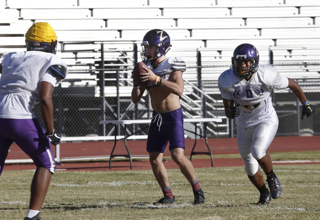 Durango High's quarterback Kaden Renshaw, center, and running back T.K. Fotu, right, during team's practice Wednesday Oct. 11, 2017, in Las Vegas. Bizuayehu Tesfaye Las Vegas Review-Journal @bizut ...