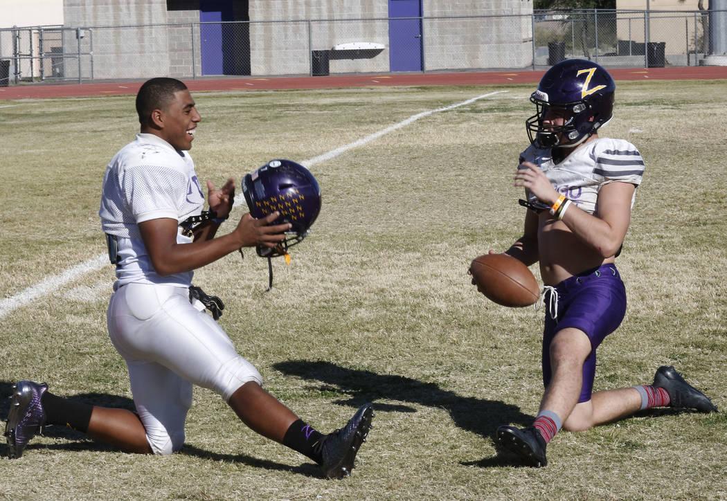 Durango High's running back T.K. Fotu, left, and quarterback Kaden Renshaw chat as they stretch during team's practice Wednesday Oct. 11, 2017, in Las Vegas. Bizuayehu Tesfaye Las Vegas Review-Jou ...