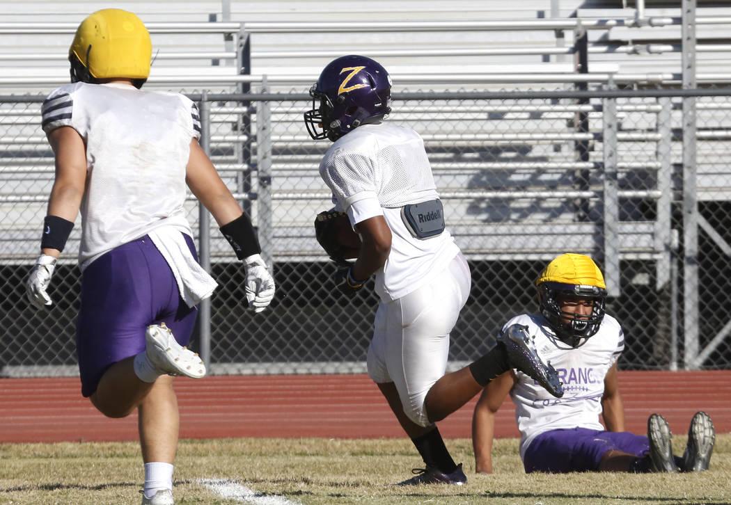 Durango High's running back T.K. Fotu, right, runs with the ball during team's practice Wednesday Oct. 11, 2017, in Las Vegas. Bizuayehu Tesfaye Las Vegas Review-Journal @bizutesfaye