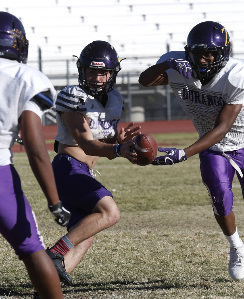 Durango High's quarterback Kaden Renshaw, center, fakes a pass during team's practice Wednesday Oct. 11, 2017, in Las Vegas. Bizuayehu Tesfaye Las Vegas Review-Journal @bizutesfaye
