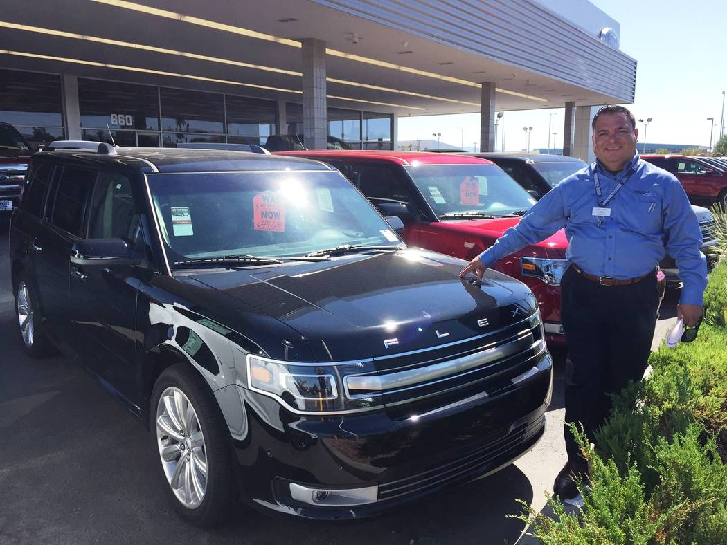 Friendly Ford Friendly Ford sales consultant Sal Lugo is seen with the 2018 Ford Flex crossover.