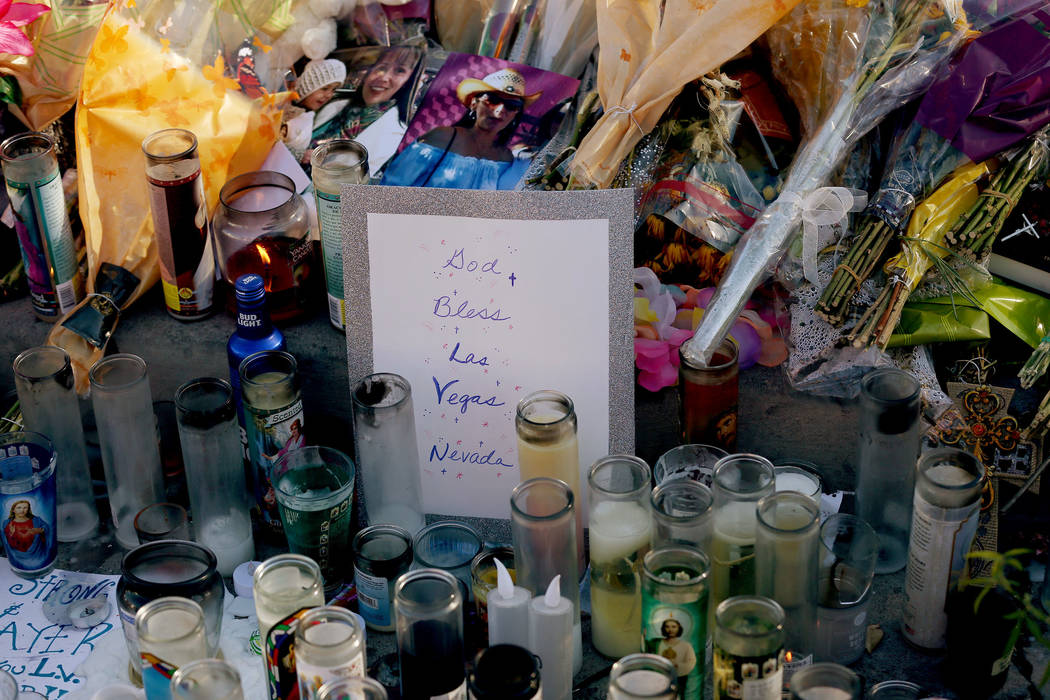 A declaration sits among candles and flowers at a memorial across the street from the Mandalay Bay and the Route 91 Harvest Festival grounds in Las Vegas, Saturday, Oct. 7, 2017. Elizabeth Brumley ...