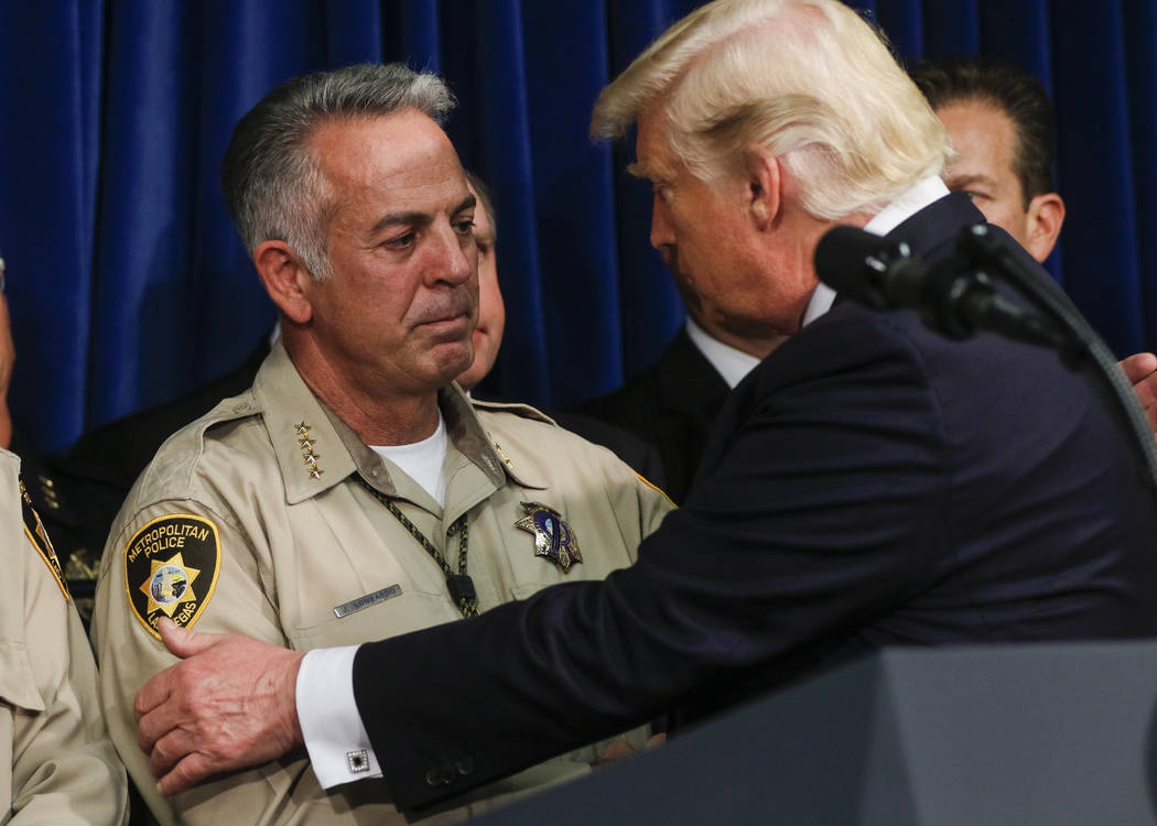 Clark County Sheriff Joe Lombardo, left, and President Donald Trump at Metropolitan Police Department headquarters in Las Vegas on Wednesday, Oct. 4, 2017. A gunman opened fire on attendees of a m ...