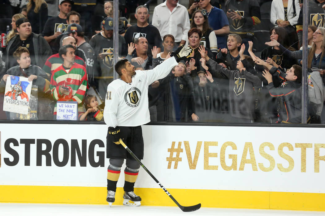 Vegas Golden Knights left wing Pierre-Edouard Bellemare (41) throws a puck over the glass for fans before the game against the Arizona Coyotes at T-Mobile Arena in Las Vegas, Tuesday, Oct. 10, 201 ...