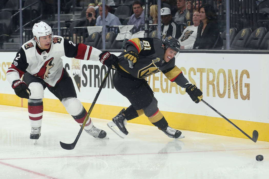 Arizona Coyotes defenseman Luke Schenn (2) and Vegas Golden Knights center Jonathan Marchessault (81) fight for the puck during the second period of the game at T-Mobile Arena in Las Vegas, Tuesda ...