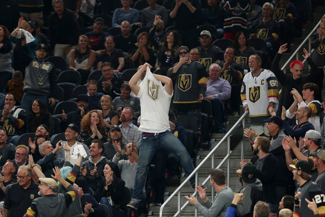 A man take his shirt off during the second period against the Arizona Coyotes at T-Mobile Arena in Las Vegas, Tuesday, Oct. 10, 2017. Bridget Bennett Las Vegas Review-Journal @BridgetKBennett