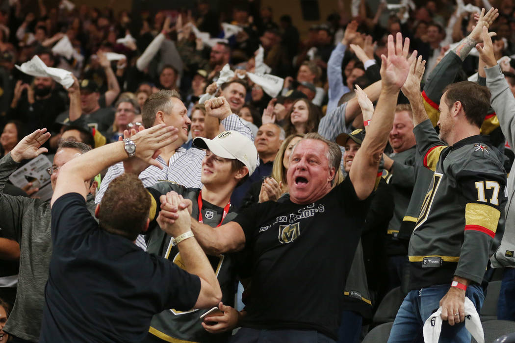Fans celebrate the Vegas Golden Knights's firth goal during the second period against the Arizona Coyotes at T-Mobile Arena in Las Vegas, Tuesday, Oct. 10, 2017. Bridget Bennett Las Vegas Review-J ...