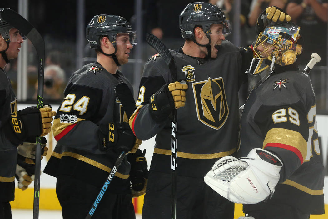 Vegas Golden Knights defenseman Brayden McNabb (3) and Vegas Golden Knights goalie Marc-Andre Fleury (29) embrace after their 5-2 win over  the Arizona Coyotes at T-Mobile Arena in Las Vegas, Tues ...
