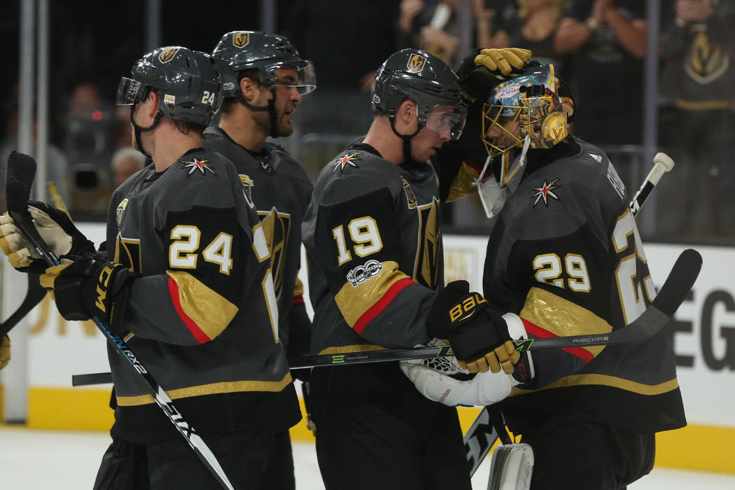 Vegas Golden Knights right wing Reilly Smith (19) and Vegas Golden Knights goalie Marc-Andre Fleury (29) embrace after the third period against the Arizona Coyotes at T-Mobile Arena in Las Vegas,  ...