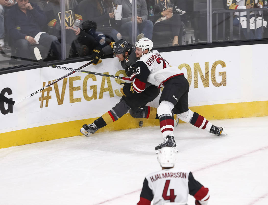 Vegas Golden Knights left wing Tomas Nosek (92) is checked by Arizona Coyotes defenseman Oliver Ekman-Larsson (23) during the second period of an NHL hockey game between the Vegas Golden Knights a ...