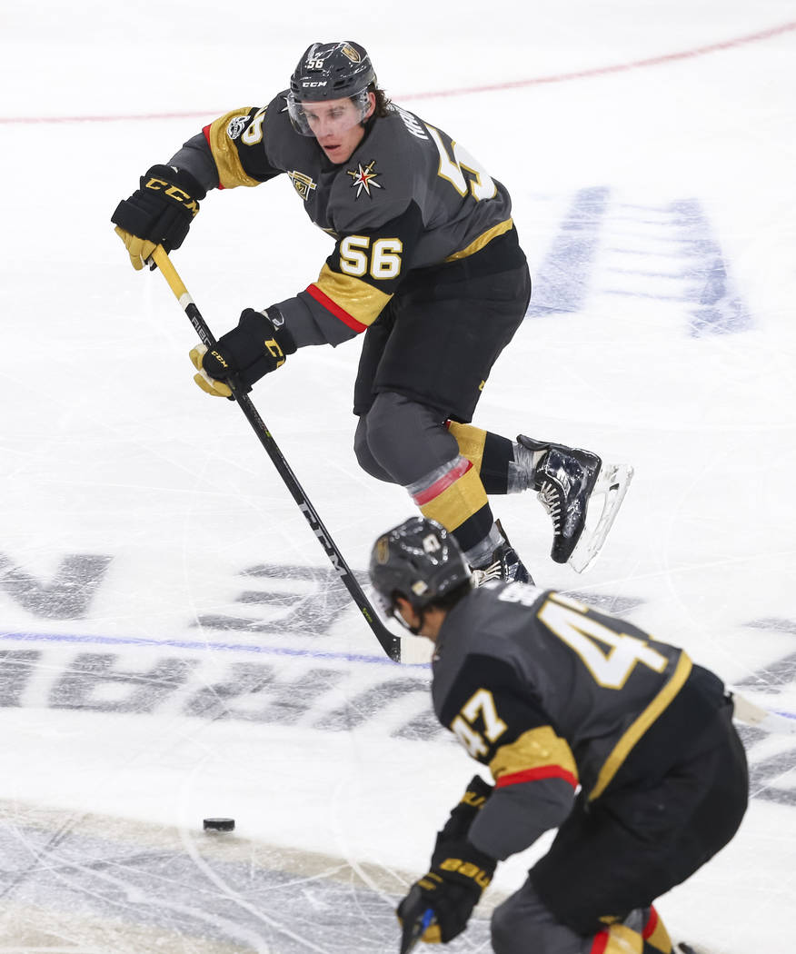 Vegas Golden Knights left wing Erik Haula (56) passes the puck to Knights defenseman Luca Sbisa (47) during the second period of an NHL hockey game between the Vegas Golden Knights and the Arizona ...