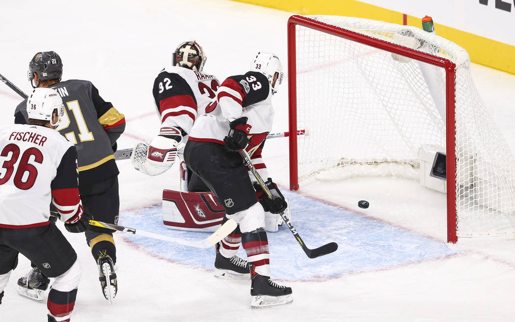 A puck shot by Vegas Golden Knights left wing James Neal, not shown, gets past Arizona Coyotes goalie Antti Raanta (32) during the first period of an NHL hockey game between the Vegas Golden Knigh ...
