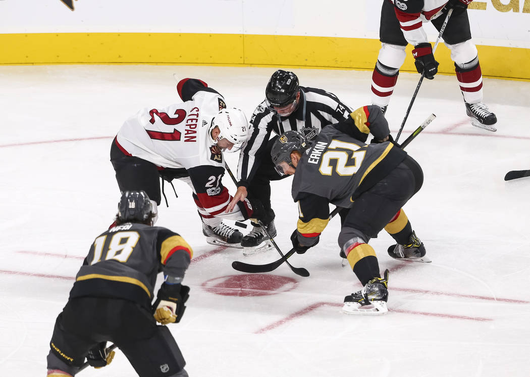 Arizona Coyotes center Derek Stepan (21) and Vegas Golden Knights center Cody Eakin (21) face off during the second period of an NHL hockey game between the Vegas Golden Knights and the Arizona Co ...
