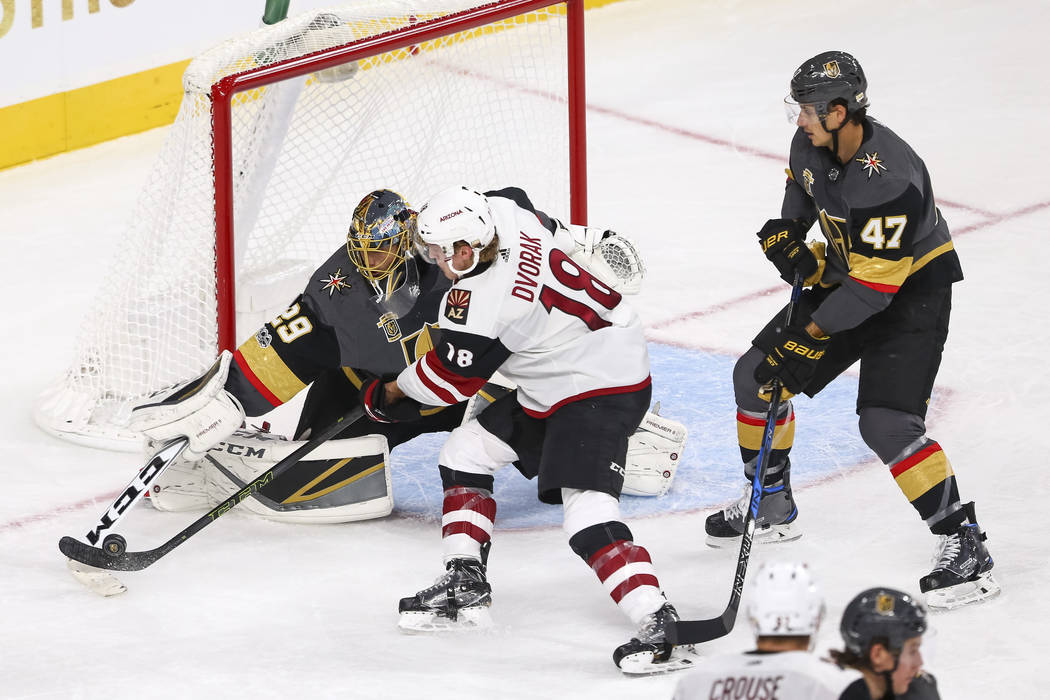 Vegas Golden Knights goalie Marc-Andre Fleury (29) deflects a shot from Arizona Coyotes center Christian Dvorak (18) during the third period of an NHL hockey game between the Vegas Golden Knights  ...
