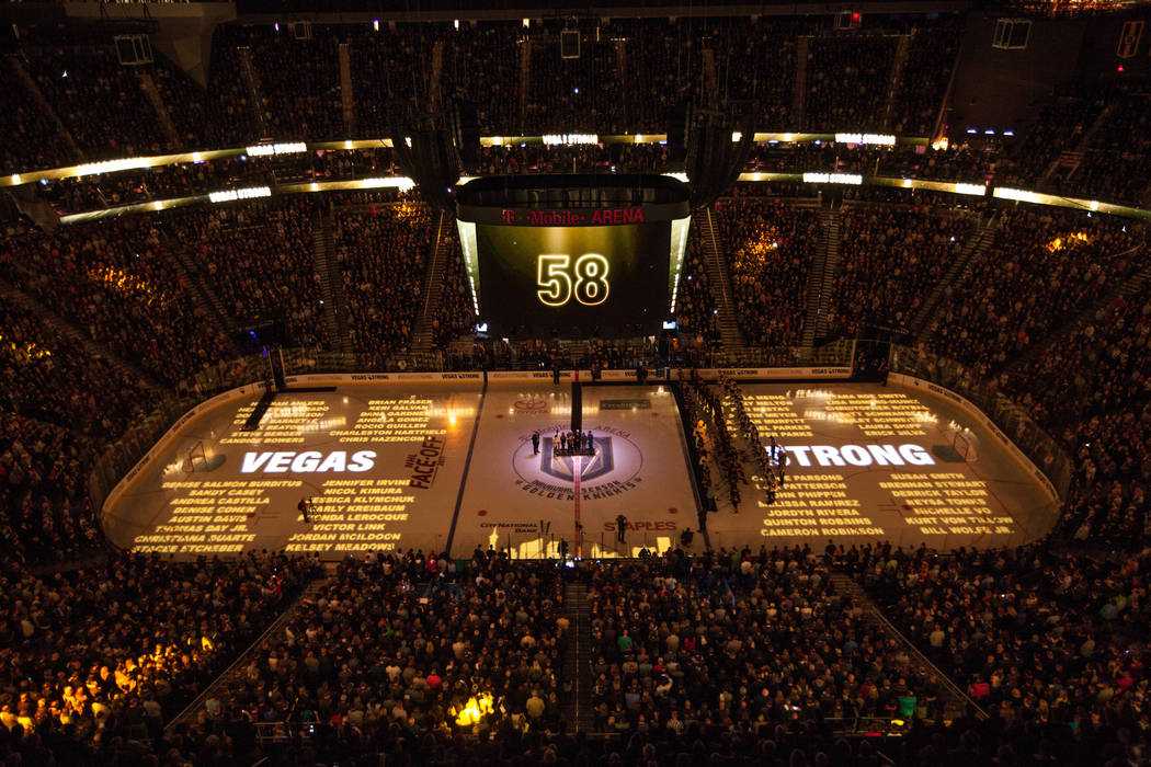 Names of the 58 people killed in the Route 91 Harvest Festival shooting are displayed on the hockey ring before the start of an NHL hockey game between the Vegas Golden Knights and the Arizona Coy ...