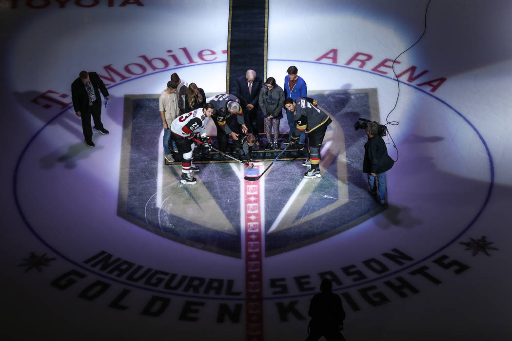 The ceremonial puck drop before the start of an NHL hockey game between the Vegas Golden Knights and the Arizona Coyotes at T-Mobile Arena in Las Vegas, Tuesday, Oct. 10, 2017. Joel Angel Juarez L ...