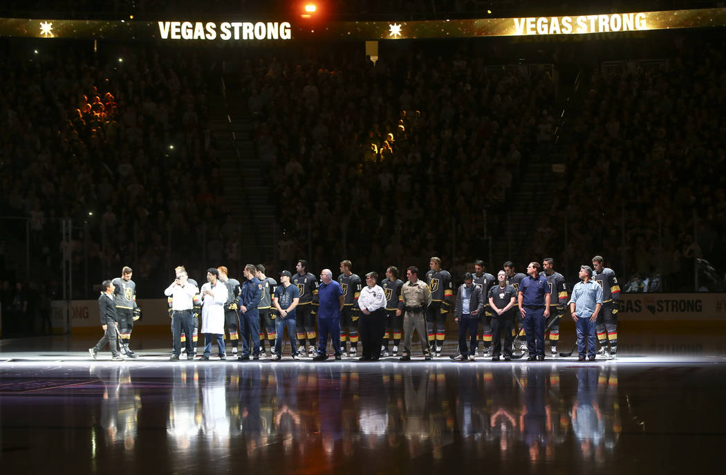 Members of the Vegas Golden Knights are introduced with first responders before playing the Arizona Coyotes in an NHL hockey game at T-Mobile Arena in Las Vegas on Tuesday, Oct. 10, 2017. Chase St ...