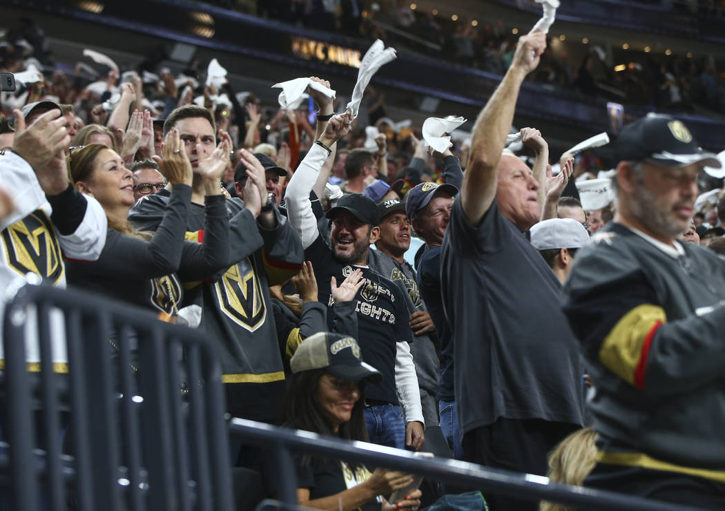 Vegas Golden Knights fans cheer after the first goal of the night, by Tomas Nosek, against the Arizona Coyotes during an NHL hockey game at T-Mobile Arena in Las Vegas on Tuesday, Oct. 10, 2017. C ...