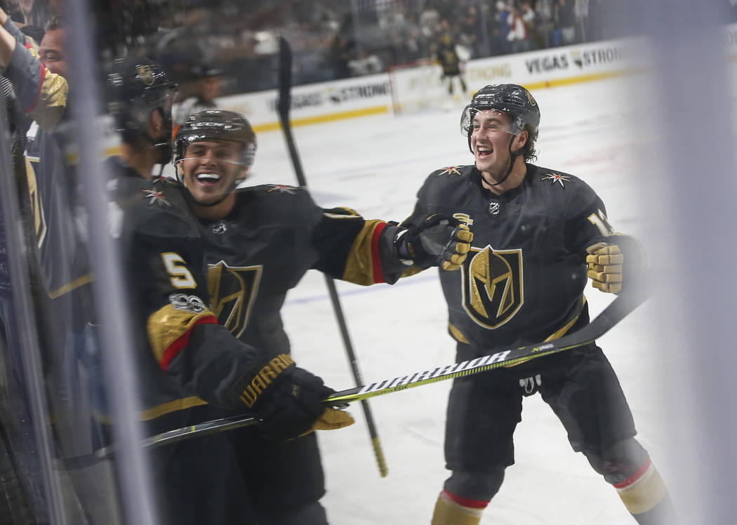 Vegas Golden Knights' Jonathan Marchessault, second from left, and Brendan Leipsic, right, celebrate a goal by Vegas Golden Knights' Deryk Engelland (5) during an NHL hockey game against the Arizo ...