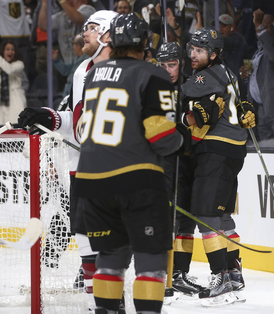 Vegas Golden Knights' James Neal, far right, is embraced by teammate Reilly Smith (19) after Neal scored the fourth goal against the Arizona Coyotes during an NHL hockey game at T-Mobile Arena in  ...