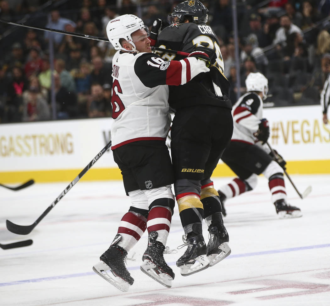 Arizona Coyotes' Max Domi (16) collides with Vegas Golden Knights' William Carrier (28) during an NHL hockey game at T-Mobile Arena in Las Vegas on Tuesday, Oct. 10, 2017. The Golden Knights won 5 ...