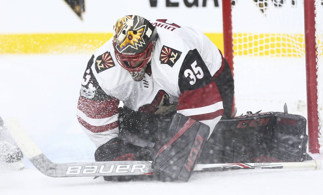 Arizona Coyotes goalie Louis Domingue (35) blocks a shot from the Vegas Golden Knights during an NHL hockey game at T-Mobile Arena in Las Vegas on Tuesday, Oct. 10, 2017. The Golden Knights won 5- ...
