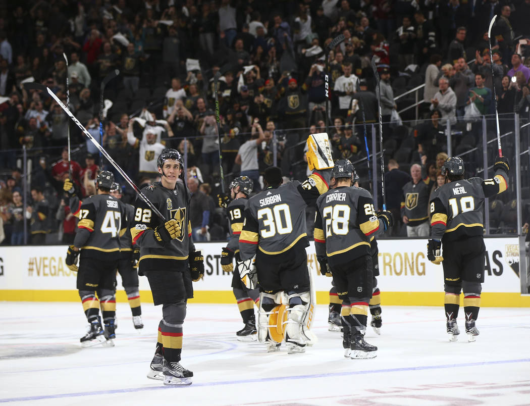 Vegas Golden Knights players celebrate after defeating the Arizona Coyotes 5-2 in an NHL hockey game at T-Mobile Arena in Las Vegas on Tuesday, Oct. 10, 2017. Chase Stevens Las Vegas Review-Journa ...