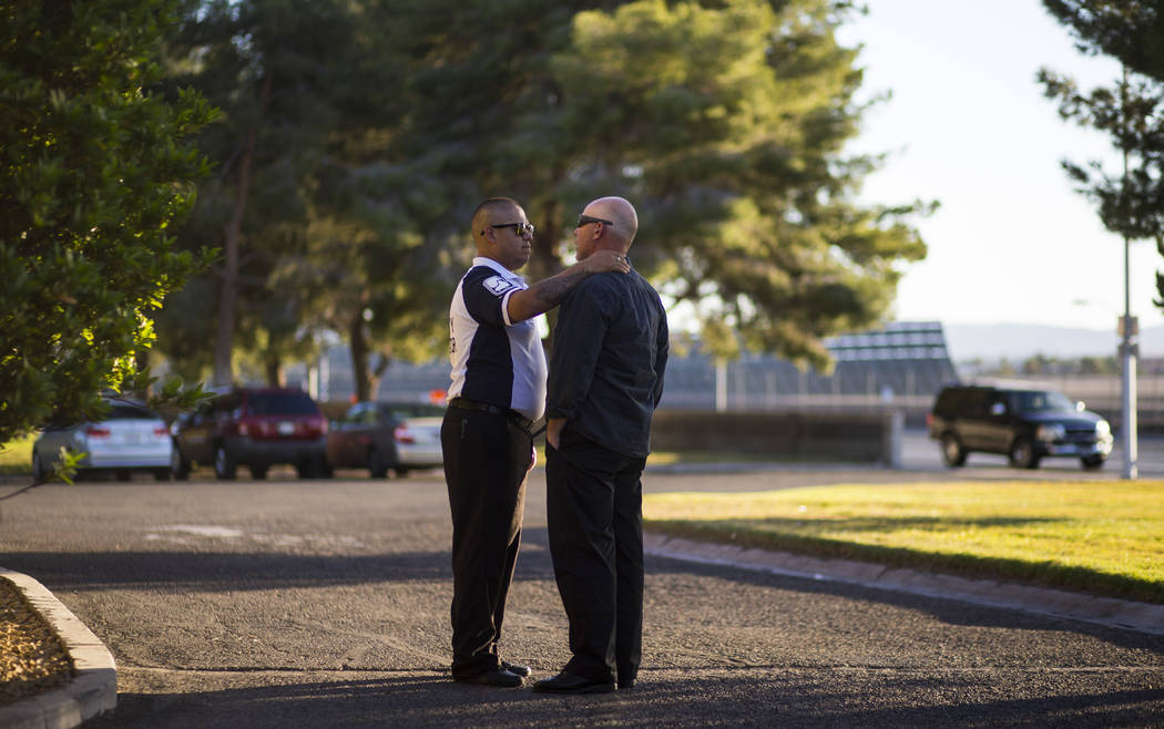 Supervisor and friend Gus A. Vega, left, comforts a coworker during a memorial service for Erick Silva, who they worked with at Contemporary Services Corporation, at Davis Funeral Home in Las Vega ...