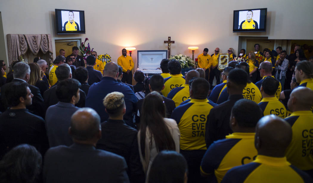 People stand during funeral services for Erick Silva at Davis Funeral Home & Memorial Park in Las Vegas on Thursday, Oct. 12, 2017. Silva was working as a security guard at the Route 91 Harves ...