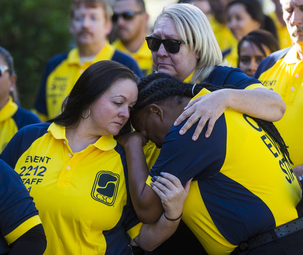 Contemporary Services Corporation employees, many of whom worked with Erick Silva, comfort one another before the start of funeral services for Silva at Davis Funeral Home & Memorial Park in L ...