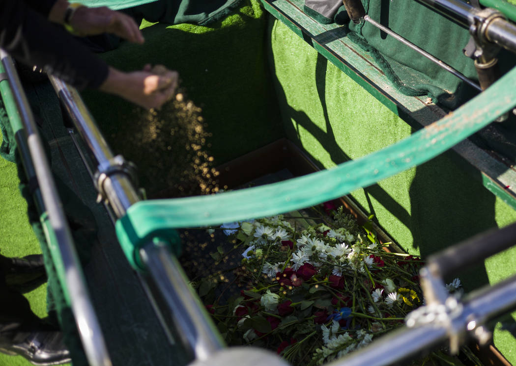 People pay their final respects during funeral services for Erick Silva at Davis Funeral Home & Memorial Park in Las Vegas on Thursday, Oct. 12, 2017. Silva was working as a security guard at  ...