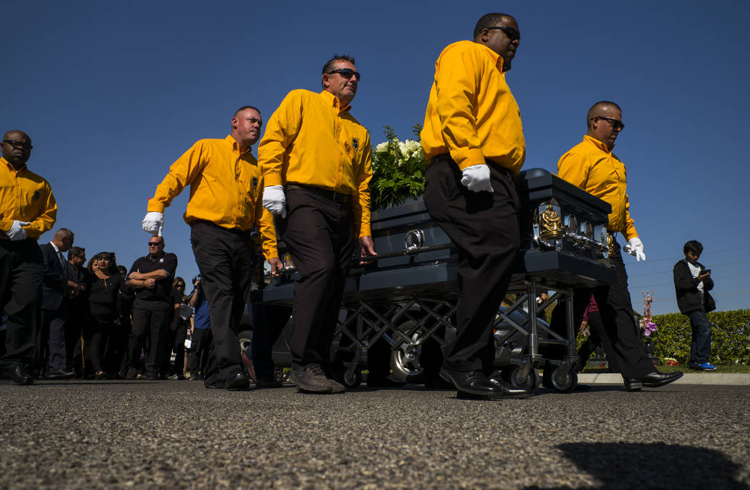 Pallbearers carry the casket of Erick Silva during funeral services at Davis Funeral Home & Memorial Park in Las Vegas on Thursday, Oct. 12, 2017. Silva was working as a security guard at the  ...