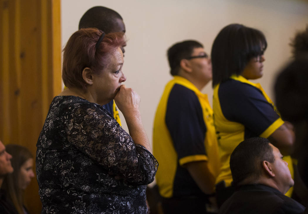A woman reacts during funeral services for Erick Silva at Davis Funeral Home & Memorial Park in Las Vegas on Thursday, Oct. 12, 2017. Silva was working as a security guard at the Route 91 Harv ...