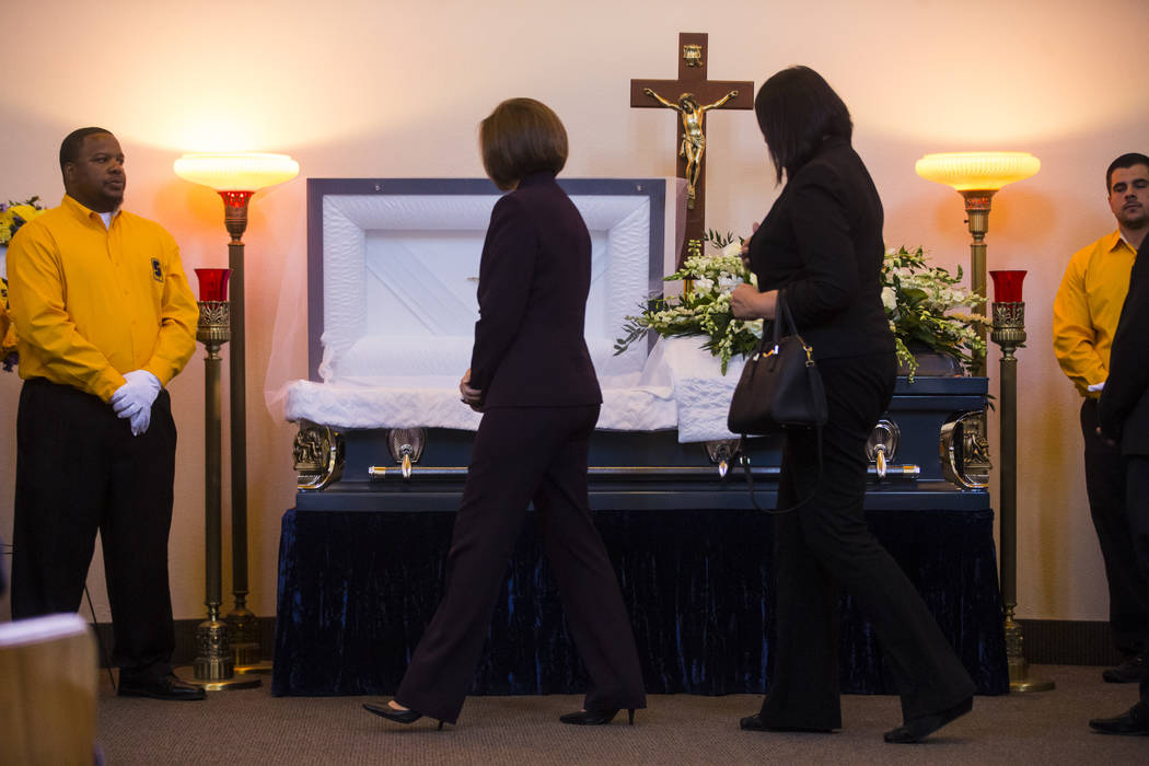 U.S. Sen. Catherine Cortez Masto, second from left, pays her respects during funeral services for Erick Silva at Davis Funeral Home & Memorial Park in Las Vegas on Thursday, Oct. 12, 2017. Sil ...