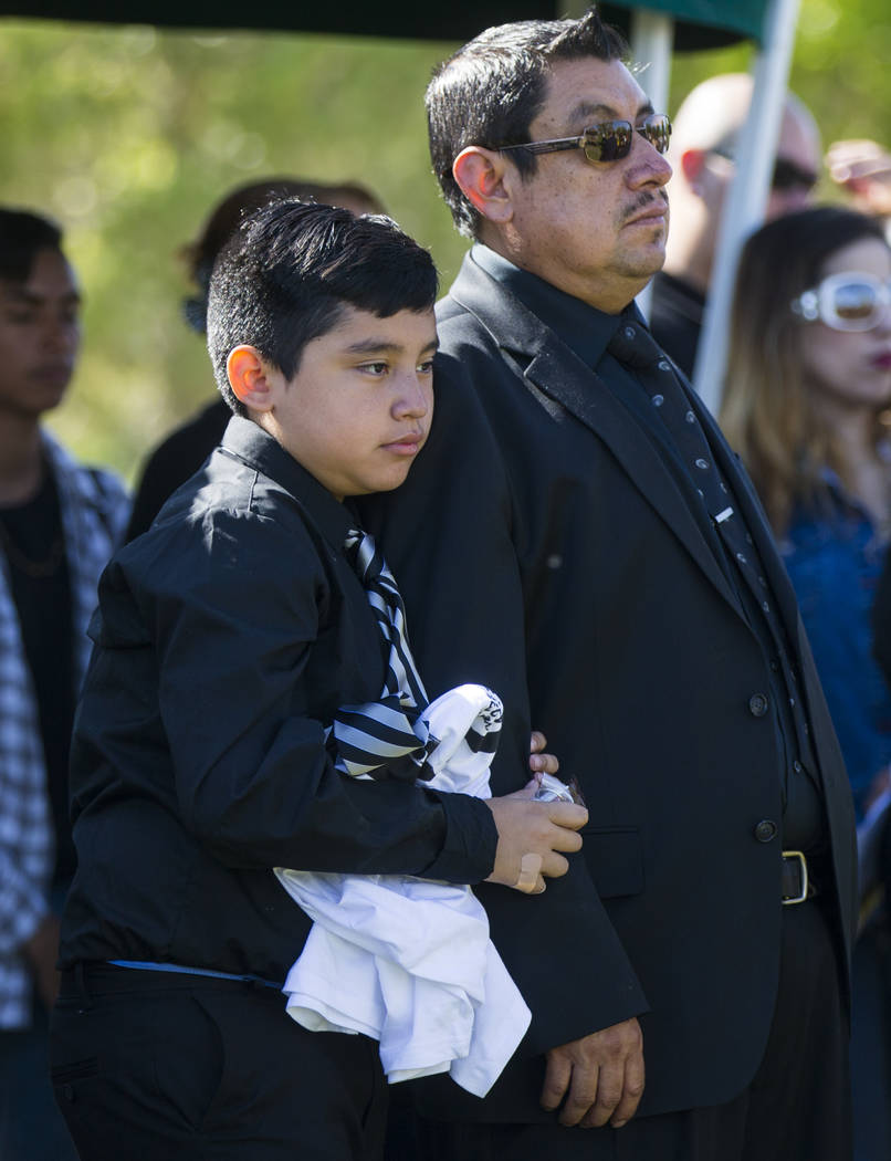 Son Arturo De La Rosa, and stepfather Gregorio De La Rosa, during funeral services for Erick Silva, at Davis Funeral Home & Memorial Park in Las Vegas on Thursday, Oct. 12, 2017. Silva was wor ...