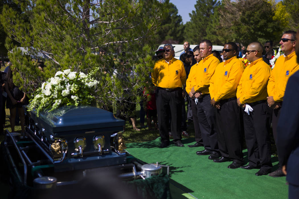 Pallbearers next to the casket of Erick Silva during funeral services at Davis Funeral Home & Memorial Park in Las Vegas on Thursday, Oct. 12, 2017. Silva was working as a security guard at th ...