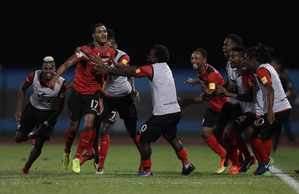 Trinidad and Tobago's Alvin Jones (17) celebrates with his teammates after scoring against U.S. during a World Cup qualifying soccer match in Couva, Trinidad, Tuesday, Oct. 10, 2017. (AP Photo/Reb ...