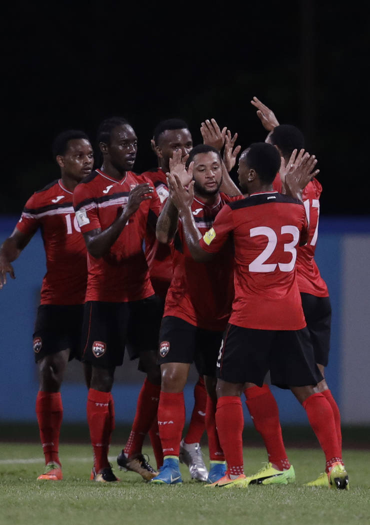 Trinidad and Tobago's Shahdon Winchester celebrates with his teammates after scoring against U.S. during a World Cup qualifying soccer match in Couva, Trinidad, Tuesday, Oct. 10, 2017. (AP Photo/R ...