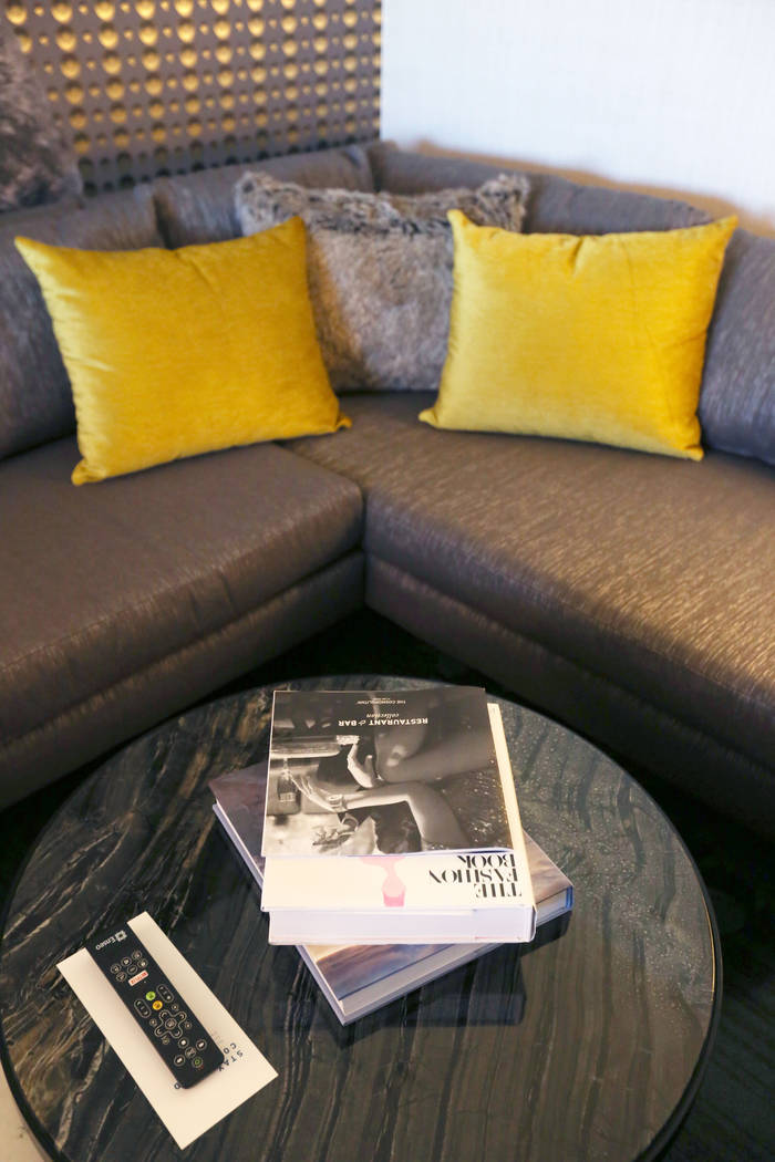 Books stacked on a coffee table as a way for a newly renovated Studio Terrace suite feels more homey, at The Cosmopolitan of Las Vegas in Las Vegas, Tuesday Oct. 10, 2017. Elizabeth Brumley Las Ve ...