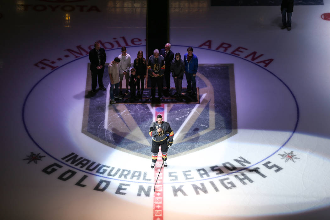 Vegas Golden Knights defenseman Deryk Engelland (5), center, speaks during a ceremony honoring victims and first responders of the Route 91 Harvest Festival shooting before the start of an NHL hoc ...