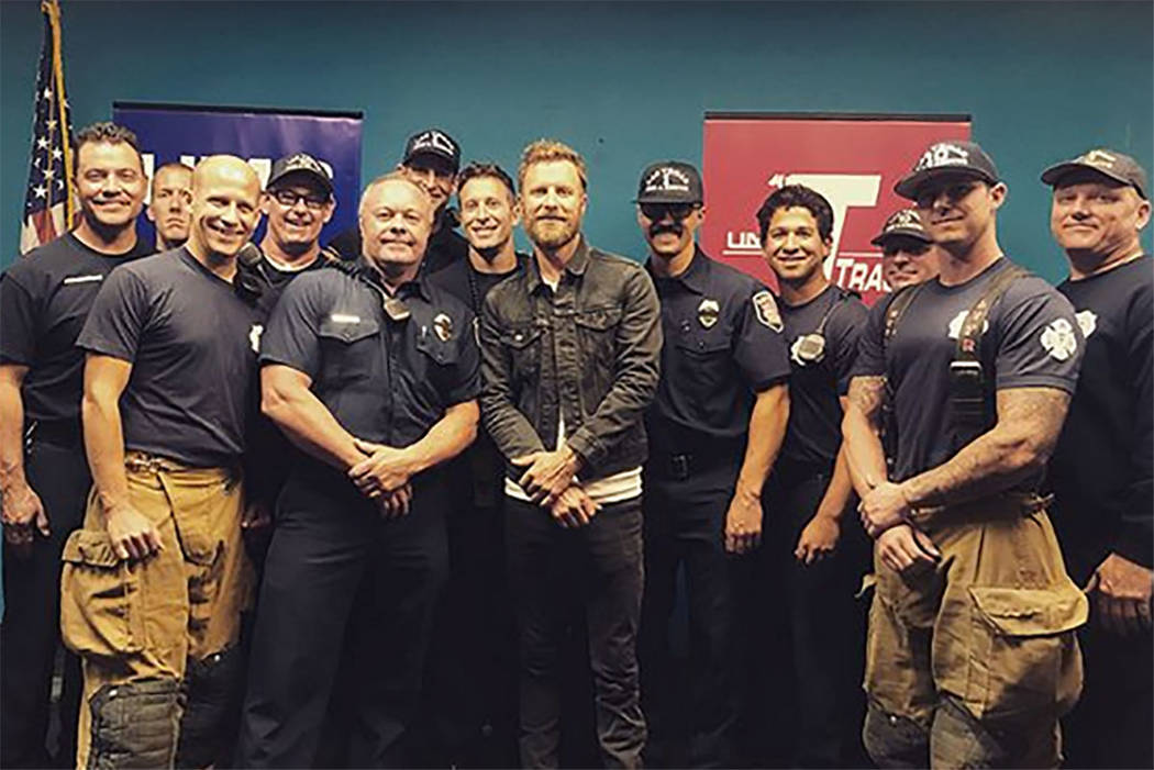 Country music star Dierks Bentley poses with first responders at University  Medical Center on Monday.