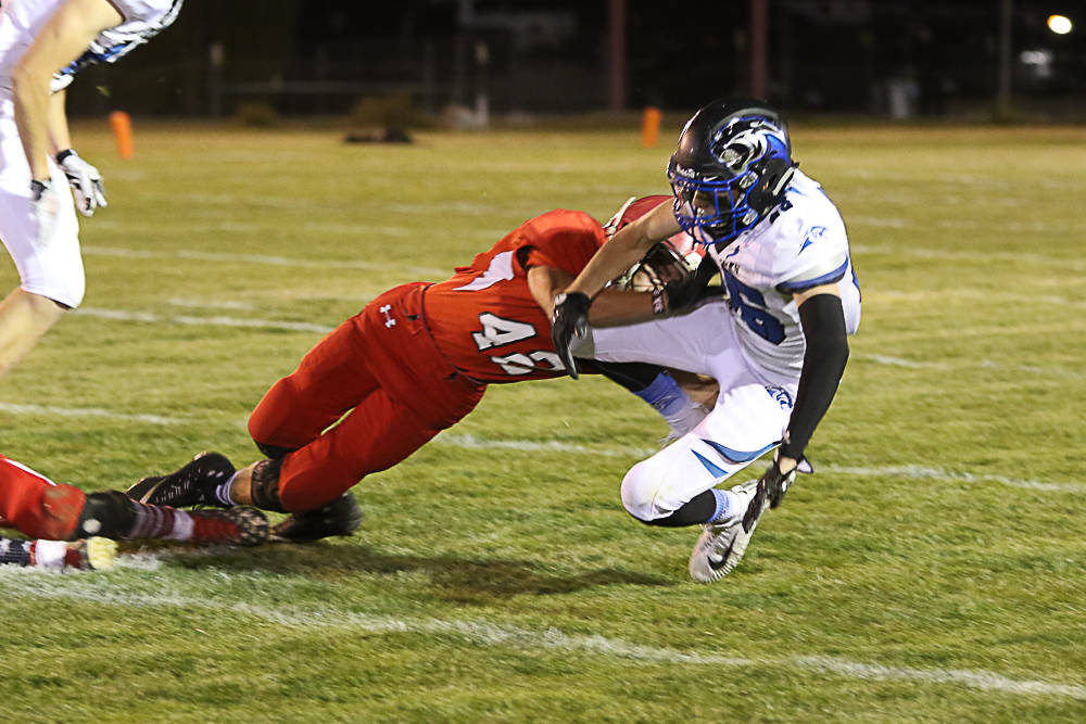 Carl Paice/Special to the Times-Bonanza & Goldfield News Vance Day  tackles an Alamo players during the game on Friday against the Panthers. Pahranagat Valley's offensive machine was too much  ...